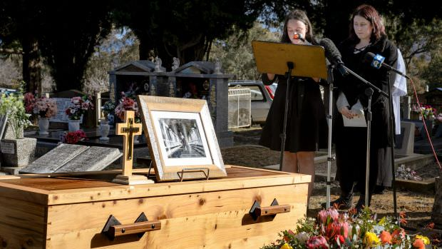 Val Jeffery's grand-daughters Madelaine and Charlotte give a reading at his funeral.