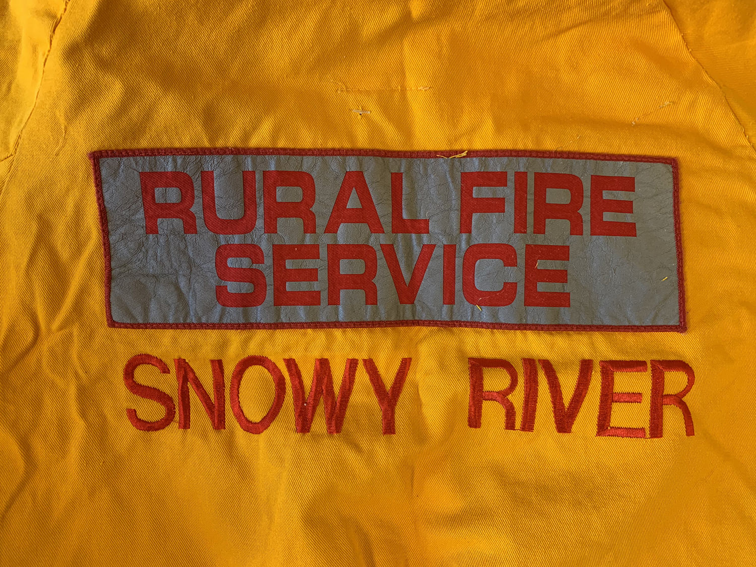 Embroidery on firefighting overalls.